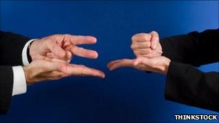 Rock-paper-scissors players (Thinkstock)