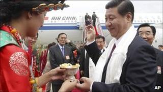 Chinese Vice President Xi Jinping, right, is welcomed upon his arrival in Lhasa, July 17, 2011