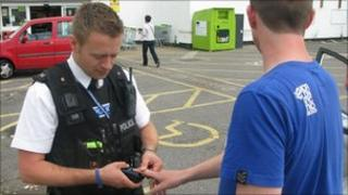 Policeman using the mobile fingerprint device