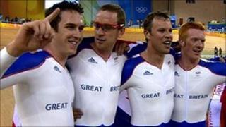 The GB men's team pursuit team celebrate gold