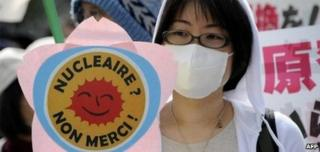 A protester holds a placard during a rally demanding the stop of the Hamaoka nuclear power plant in Tokyo on April 10, 2011