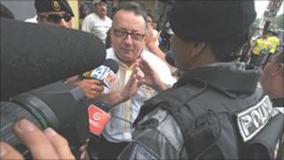 Columnist Emilio Palacio outside the court