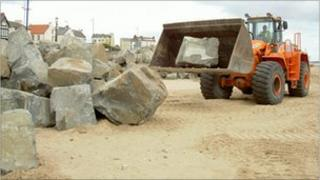 Some of the rock armour stockpiled ready for installation