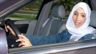 Manal al-Sharif behind the wheel (Facebook profile pic)