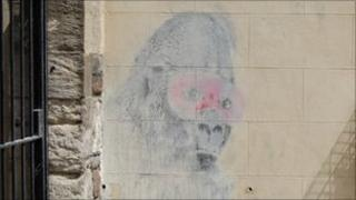 Banksy painting on wall in Eastville
