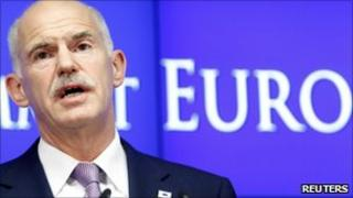 Greece's Prime Minister George Papandreou talks to media during a news conference at the end of an Eurozone leaders crisis summit in Brussels, 21 July 2011