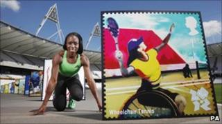 Jeanette Kwakye with an image of one of the stamps