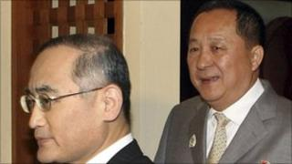 South Korea's Wi Sung-lac (left) and North Korea's Ri Yong-ho meet at Asean in Bali on 22 July 2011