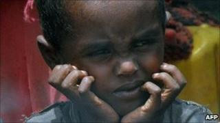 Displaced Somali boy waits for food aid at a camp in Mogadishu - 24 July