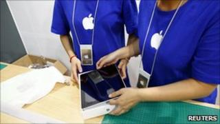 Staff in fake Apple store, Reuters