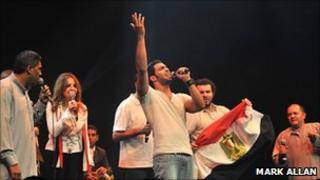 Azza Balba, Ramy Essam and members of El Tanbura