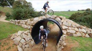 Two riders tackle the tunnel and overpass section of the Olympic mountain bike venue at Hadleigh Farm