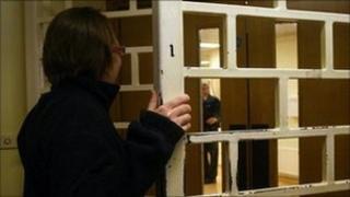 A staff member makes her way through security doors