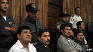 From left, in front row, Daniel Martinez, Carlos Carias, Manuel Pop and Reyes Collin wait in court during their trial in Guatemala City (25 July 2011)