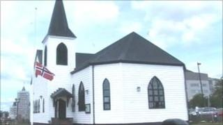 The flag flies at half-mast outside the Norwegian Church in Cardiff Bay