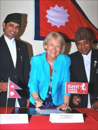 Pashupati Parajuli and Ghanshyam Khatiwada with KCC's chairman Paulina Stockell signing the agreement for Nepal to come to Kent to train