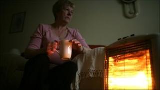 Pensioner by her electric bar fire