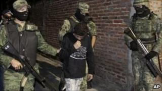 Mexican soldiers present Edgar Jimenez Lugo to the media in the city of Cuernavaca, Mexico - 3 December 2010.