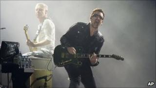 Bono, right, and Adam Clayton, from the rock group U2