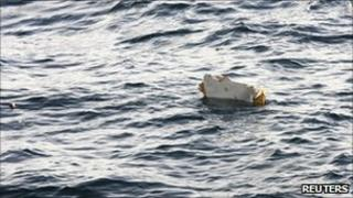 Debris from the Asiana Airlines cargo plane floats in the sea off Jeju island, 28 July
