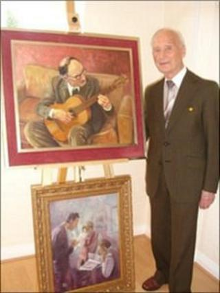 James Mills pictured with two of his paintings