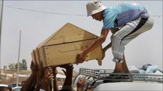 Casket of Muhsin Ali, 22, killed in a double car bomb attack in Najaf, June 2011