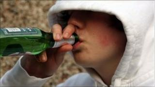 Youth drinking beer from a bottle