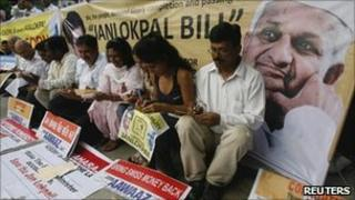 Anti-corruption campaigners in the northern Indian city of Chandigarh on 31 July 2011