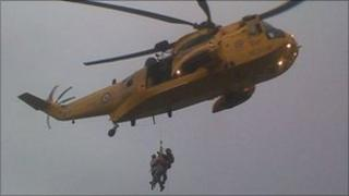 RAF helicopter crew rescue stranded walkers in Langland Bay, Swansea
