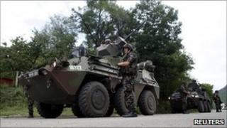 Kfor troops from Slovenia stand on the road in the village of Rudare near the town of Zvecan, Kosovo - 2 August 2011