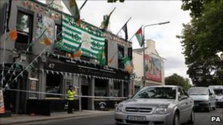A police officer stands outside of the Players Lounge Pub in Fairview, Dublin