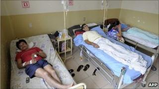 People in hospital in Ricaurte, Ecuador on 18 July 2011