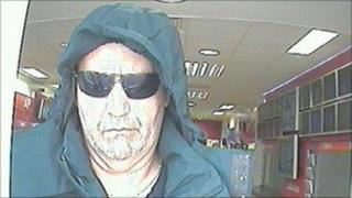 A man police are trying to trace after an armed robbery in Swadlincote