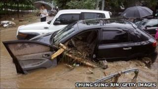 Flood water after a torrential rain storm hit Seoul