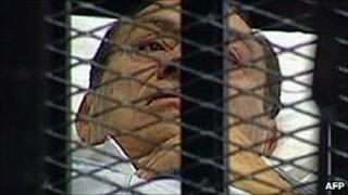 Hosni Mubarak is brought into court in Cairo in this image from state TV