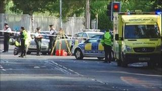 Accident scene with police and ambulance crews