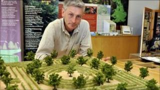Mark Ellis with model of the proposed maze for Dalby Forest. Copyright: Forestry Commission