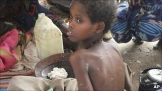 A child from southern Somalia takes food at a camp in Mogadishu, Somalia, Wednesday 3 August 2011