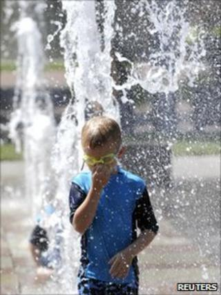 A boy standing in a fountain in Kansas City in Missouri