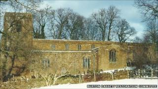 All Saints Church in Burton Dassett, surrounded by snow