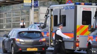 Police at the scene outside Tottenham Hale Tube station