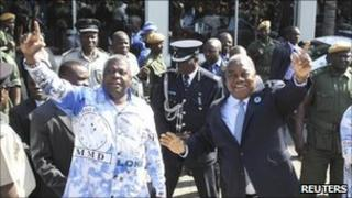 President Rupiah Banda (r) waves to supporters at a rally in Lusaka earlier this month