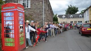 Villagers outside the phone box at Llanfrynach