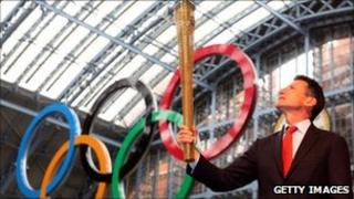 Sebastian Coe with the Olympic torch at St Pancras station