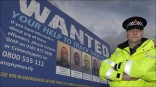 Police van with wanted poster