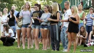Members of the Copley community holding a candlight vigil