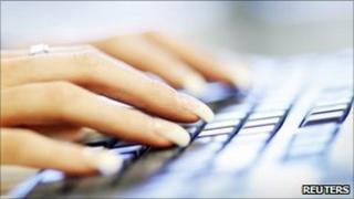 woman's fingers on keyboard
