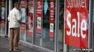 Sale signs in shop windows