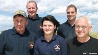 Paige Anderson (centre), Michael Anderson (right) and members of the Caister-on-Sea Lifeboat crew in Norfolk (Photo: Matt Sansom)