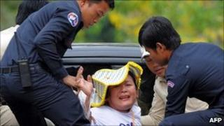 A Cambodian villager from Boeng Kak lake is detained by police during a protest in Phnom Penh on March 25, 2011
